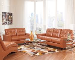 ashley leather sofa set paulie durablend leather orange sofa collection ashley furniture