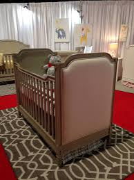 haven cottage upholstered crib in gray from recent trade show