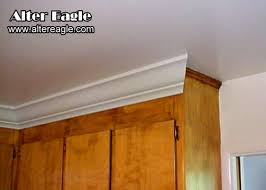 how to add crown molding to kitchen cabinets installing crown molding above kitchen cabinets kitchen remodel