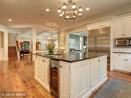 traditional kitchen with hardwood floors crown molding in