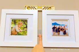 arranging multiple picture frames on the wall my big fat happy life
