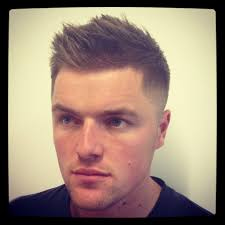 regueler hair cut for men a man with a regular fade haircut and short hair on his head