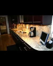 beautiful kitchen dark custom cabinets tumbled marble backsplash