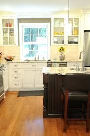 white kitchen cabinets with black island hickory and center dark