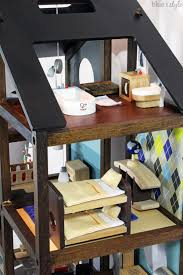 How To Make A Dollhouse Out Of A Bookcase Diy With Style How I Turned An Off The Shelf Dollhouse Into Our