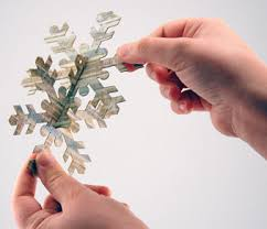 laser cut snowflake ornaments from paper wood and foam