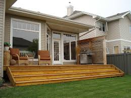 small yard deck design with wooden fence and tree inspirations