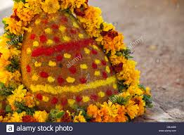 hindu garland hindu temple shrine surrounded with a flower garland in a