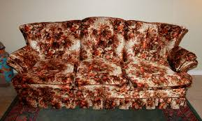 ugly couch across time and space with orange and brown and flowers and clocks