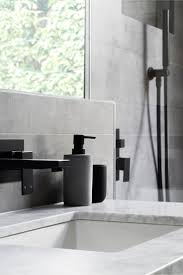 best images about modern bathroom design pinterest this modern grey and white bathroom matte black accents like soap pumps hardware