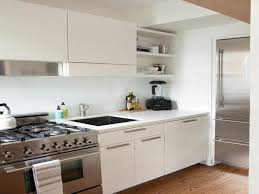 white kitchen cabinets with stainless steel appliances white