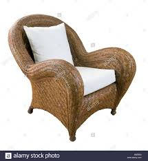 a large wicker chair with white cushions stock photo royalty free