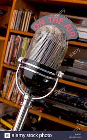 ontheair old fashioned radio studio microphone with illuminated on the air
