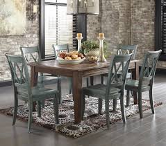 jlester407 or this mestler 7 piece table set with antique