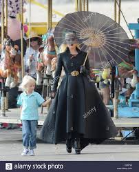 wes bentley american horror countess lady gaga dress in all black for a beach carnival scene