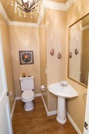 Powder Room With Pedestal Sink Corner Pedestal Sink Powder Room Traditional With Brown Walls