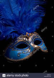 blue masquerade masks a blue masquerade mask on black background stock photo royalty