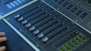 sound designer sound designer working on the sound moving fader up and