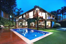 home designs with courtyard pool interesting design modern tropical contemporary house design with bright lighting ideas also elegant pool courtyard well creative plants terrace decor