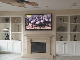 fireplace hang tv over fireplace mounting tv over fireplace