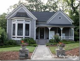 grey roof cottage light grey field white trim dark grey accents
