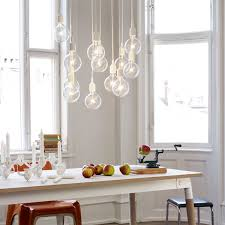 cluster of e27 lamps over the dining table kitchen dining