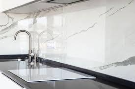 white kitchen cabinets with black quartz 4 reasons to choose black quartz countertops