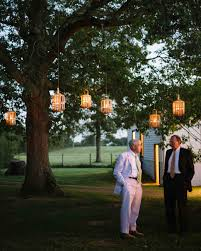 Outdoor Hanging Lights For Trees Outdoor Wedding Lighting Ideas From Real Celebrations Martha