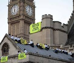 greenpeace scales british houses of parliament photo gallery