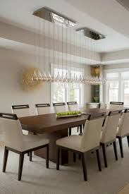 75 best inviting dining rooms images on pinterest pulte homes this modern dining room features a long glass chandelier hung over a warm wood dining table