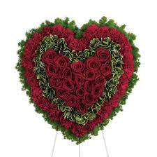 enchanted florist shaped funeral flowers with roses