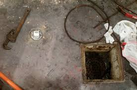 plumbing sewer backup through basement floor drain after heavy