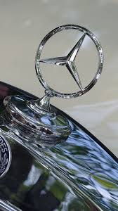 mercedes benz logo wallpapers mercedes benz logo emblem hood cars closeup 720x1280