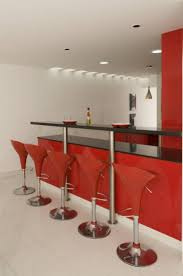 home bar decor with red stools and black soapstone countertop