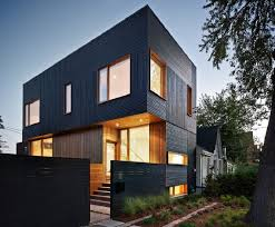modern home architects house 3 is a green roofed modern home in toronto that seems to glow