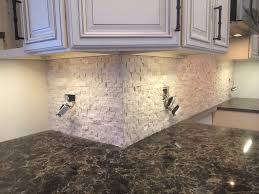 neutral beige travertine backsplash and cambria laneshaw quartz