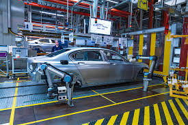 bmw factory tour bmw group shows off fancy robots in its factories humans will