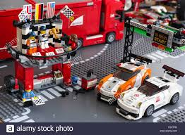 porsche lego set winning podium with two drivers and photographer in porsche 911 gt