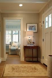 entryway with floor to ceiling board n batten creamy color with