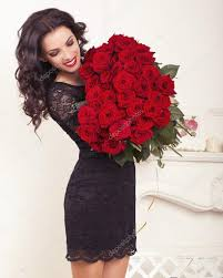 big bouquet of roses woman in lace dress holding a big bouquet of