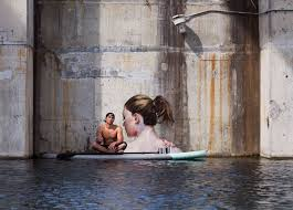 paint places street artist hula uses paddleboard to paint in hard to reach places