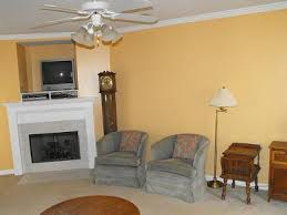 livingroom walls a shade of yellow paint on our living room walls