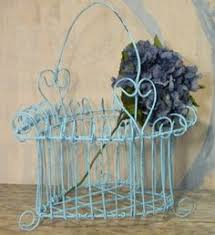 Shabby Chic Wire Baskets by Braided Metal Wire Basket With Cut Metal Colored Flowers On Rim