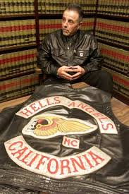 former hells angels leader charged in firebombing of tattoo shops