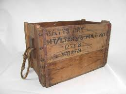 large wooden box with rope handles