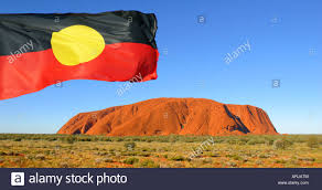 Indigenous Flags Of Australia Aboriginal Flag Over Uluru Northern Territory Australia Stock