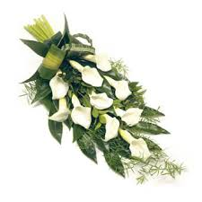 Calla Lily Bouquets A Tied Funeral Bouquet With White Calla Lilies And Greenery