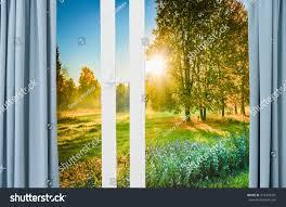 beautiful sunrise sunshine view window curtains stock photo