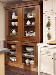 kitchen cabinets that look like furniture blue and white china in a pretty cabinet stick with the classics