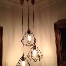 love this grouping of these kmart geo pendant lights using the